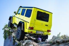 期待新的展示汽车G 500 4x4,汽车展示会日内瓦的奔驰车电视2015年 免版税图库摄影
