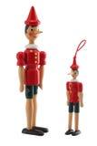 木偶奇遇记在白色隔绝的玩具雕象 图库摄影
