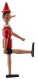 木偶奇遇记在白色隔绝的玩具雕象 免版税库存照片