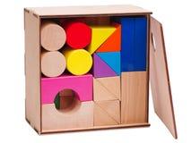 木儿童的` s,几何形状,堆积在箱子,隔绝在白色背景 免版税库存图片