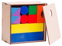 木儿童的` s,几何形状,堆积在箱子,隔绝在白色背景 免版税库存照片