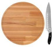 木切板和刀子,在白色背景 顶视图 库存图片