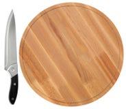 木切板和刀子,在白色背景 顶视图 免版税库存照片