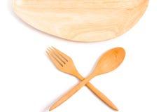木匙子和叉子在被隔绝的背景 免版税图库摄影