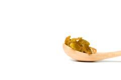 木匙子用干葡萄干 库存图片