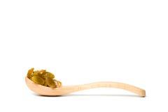 木匙子用干葡萄干 图库摄影