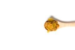 木匙子用干葡萄干 库存照片