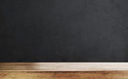 木台式有defocus黑色墙壁背景 免版税库存图片
