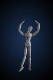 木在典雅的跳舞移动的小雕象上升的胳膊在黑暗  免版税图库摄影