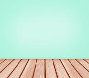 木地板和蓝绿色墙壁背景 库存照片