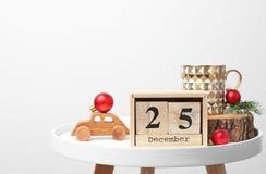 木块日历和装饰在桌上 christmas countdown 免版税库存照片