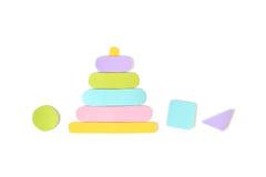 木堆积的圆环玩具纸在白色背景切开了 图库摄影
