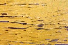 木头被绘的橙色油漆 免版税库存图片