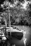 木小船在河 免版税库存照片