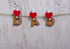 木形成词组爸爸的信件和心脏 免版税图库摄影