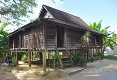 木房子的马来西亚人 免版税库存图片