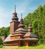 木教会在森林里,乌克兰 免版税库存照片