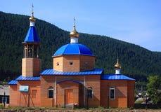 木教会在Nizhneangarsk,俄罗斯 库存图片
