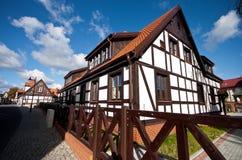 木材房子在波兰,乌斯特卡 库存图片
