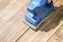 木板和蓝色研磨机 免版税图库摄影
