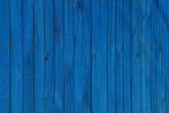 木板条蓝色纹理在篱芭的 库存照片