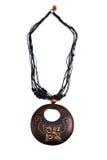 木棕色项链的垂饰 免版税库存照片