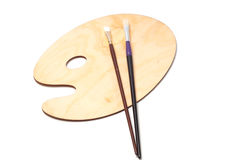 木油漆调色板和刷子 免版税库存照片
