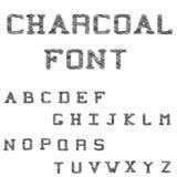 木炭字体 大黑色打印的拉丁字母 免版税库存照片