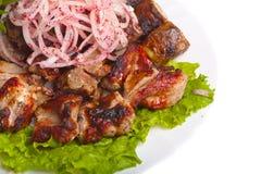 木炭煮熟的油煎的肉葱  库存照片