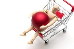 木玩偶和圣诞节球和购物车在白色backgr 图库摄影