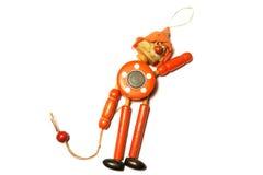 木玩具坚强的拉扯小丑 库存图片