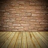 木甲板地板和石头砖墙 免版税库存照片