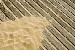 木甲板的沙子 库存照片