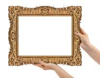 木画框在手上 免版税库存照片