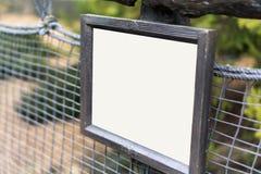 木白色空白的警告路标 库存照片