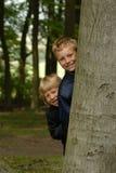 木的男孩 图库摄影