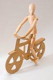 木的自行车骑士 免版税图库摄影