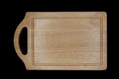 木砧板在黑背景中 免版税库存照片
