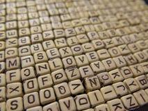 木立方体背景与形成词Lo的信件的 图库摄影