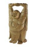 木笑的人的雕象 免版税库存图片