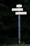 木箭头交叉路定向的符号 库存图片