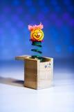从木箱子的小的小丑惊奇 免版税库存图片
