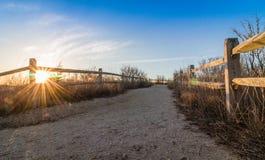 木篱芭在开普梅, NJ带领靠岸在灯塔附近,在一个晴朗的早晨 图库摄影