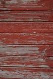 木纹理墙壁外部-红色 库存图片