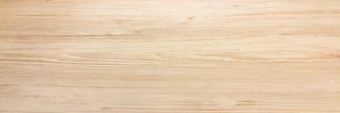 木纹理背景,点燃被风化的土气橡木 显示木纹纹理的退色的木被涂清漆的油漆 硬木 免版税库存图片