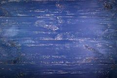 木纹理背景 老木纹理的表面 委员会在深蓝被绘 库存照片