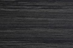木背景特写镜头  黑色乌木消耗大的喂res纹理木头 免版税图库摄影