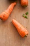 木背景的红萝卜 图库摄影