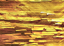 木背景的金子 库存图片