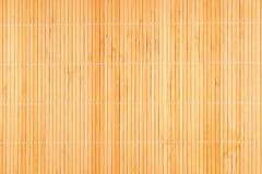 木背景竹的席子 库存图片